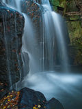 Sunlit waterfall in the autumn Stock Image