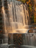 Sunlit waterfall in the autumn Royalty Free Stock Photography