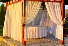 Sunlit white wooden altar Stock Photo