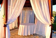 Sunlit white wooden altar Royalty Free Stock Photos