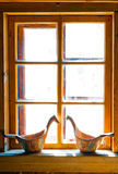 Sunlit window Russian  huts and carved buckets Royalty Free Stock Image