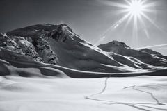 Sunlit winter mountain landscape. Sunshine. Black and white. Davos, canton Graubenden, Swiss Alps. Image with high contrast Stock Photos