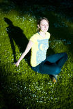 Sunlit woman in shadowy park stock photos