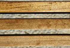 Wood Beams Background. Sunlit wooden beams on blurry background Royalty Free Stock Images