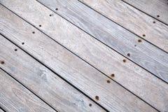 Diagonal Wooden Deck. Sunlit wooden deck, depicted diagonally Royalty Free Stock Images