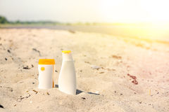 Sunlotion in the sand on a beach Royalty Free Stock Photo