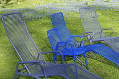 Sunlounger in a garden. In spring Stock Photos
