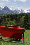 Sunlounger in the mountains. A person sitting in a Sunlounger in the mountains in spring Stock Photos