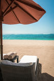 Sunlounger on a tropical beach Royalty Free Stock Image