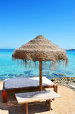 Sunlounger and umbrella in Ibiza, Spain Stock Photo