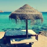 Sunlounger and umbrella in Ibiza, Spain Stock Photo
