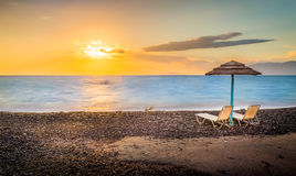 Sunloungers на восходе солнца Стоковые Изображения