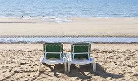 Sunloungers on the beach Royalty Free Stock Photo