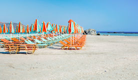 Sunloungers on a beach Royalty Free Stock Image