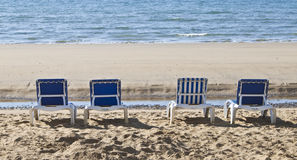 Sunloungers lined up on the beach Royalty Free Stock Photo