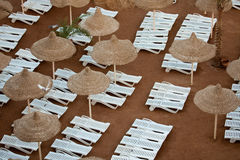 Sunloungers and sunshades on the beac Royalty Free Stock Image