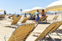 Sunloungers and umbrellas in a beach Royalty Free Stock Photography