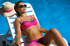 Sunning woman at poolside Royalty Free Stock Photos