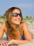 Sunny. Pretty girl relaxing on the beach Royalty Free Stock Photos