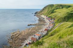 Sunny afternoon in Crovie, small village in Aberdeenshire, Scotland. Royalty Free Stock Photos