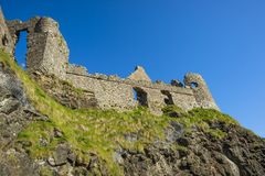 A sunny afternoon at Dunluce castle.  royalty free stock photos