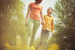Sunny afternoon mom and son outings are the best. Mother and son in the park royalty free stock photos