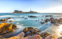 Sunny afternoon rock lighthouse Stock Photography