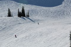 Skiing slopes Whistler BC Canada. A sunny afternoon skiing in Whistler BC top of the mountain. Great holiday in Canada stock image