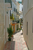 Sunny alley in Marbella Royalty Free Stock Photos