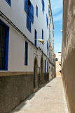 Sunny alley in the medina of Essaouira, Morocco Royalty Free Stock Photo