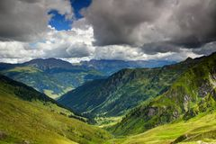 Sunny alpine meadows and forests of Carnic and Gailtal Alps Royalty Free Stock Photos