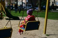 Baby on the swing. royalty free stock photography