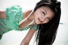 Sunny asian girl in green. With long black hair Royalty Free Stock Photo