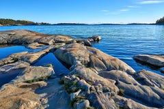 Beautiful autumn day at seashore in archipelago. Sunny autumn day. Blue sea and rocky sea shore. Bright blue sky royalty free stock image
