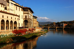 Sunny autumn day in florence river with bridge Royalty Free Stock Image