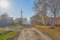 Sunny autumn day street of a small town Royalty Free Stock Photography