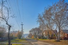Sunny autumn day street of a small town Stock Photo