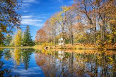 Sunny autumn in the park over lake Royalty Free Stock Photography