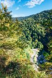Sunny autumn landscape with road and river in the foothills of Adygea. Top view Royalty Free Stock Photography