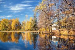 Sunny autumn in the park over lake. Sunny autumn landscape with blue sky over the lake Royalty Free Stock Photos