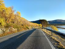 Sunny autumn road in Alta Finnmark Norway. Wonderfuf sunny fall road in Northern Norway, Alta, Finnmark, nobody here, total loneliness Stock Image