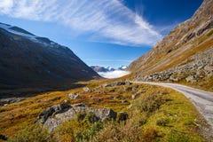 Sunny autumn road Norway Gamle Strynefjellsvegen Stock Photos