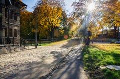 Sunny autumn street with stony road of Riga, Latvia Royalty Free Stock Photo