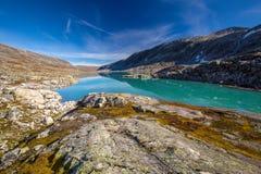Sunny autumn view Norway Gamle Strynefjellsvegen Langvatnet lake Royalty Free Stock Images