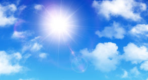 Sunny background, blue sky with white clouds and sun Stock Image