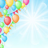 Sunny background with color balloons and flags Stock Images
