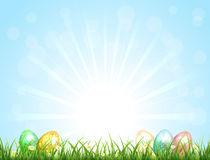 Sunny background with Easter eggs Stock Images