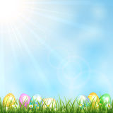 Sunny background with grass and eggs Stock Photo