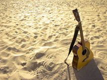 Sunny Beach Acoustic Guitar. An acoustic guitar standing in the sandy beach royalty free stock image