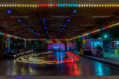 SUNNY BEACH, BULGARIA - September 10, 2017: Attraction in the park.  The bright strips of dodgem. Electric bumper car in motion at Stock Photo